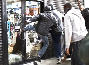 looter kicking in a shop window