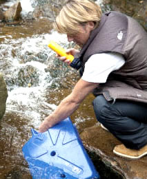 man filling a lifesaver jerry can