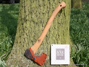 survival axe leaning on a tree