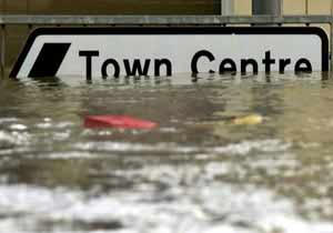 road sign under flooded water