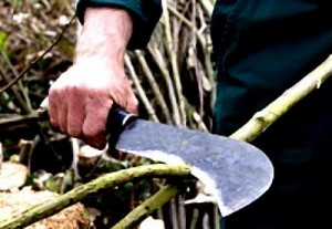man using a billhook machete